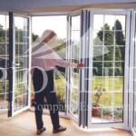 Man next to open aluminium bi-fold door