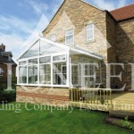 Gable conservatory side view across garden