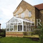 Gable conservatory with decking and house view