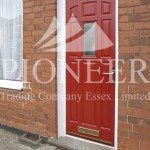 Red uPVC door angled view